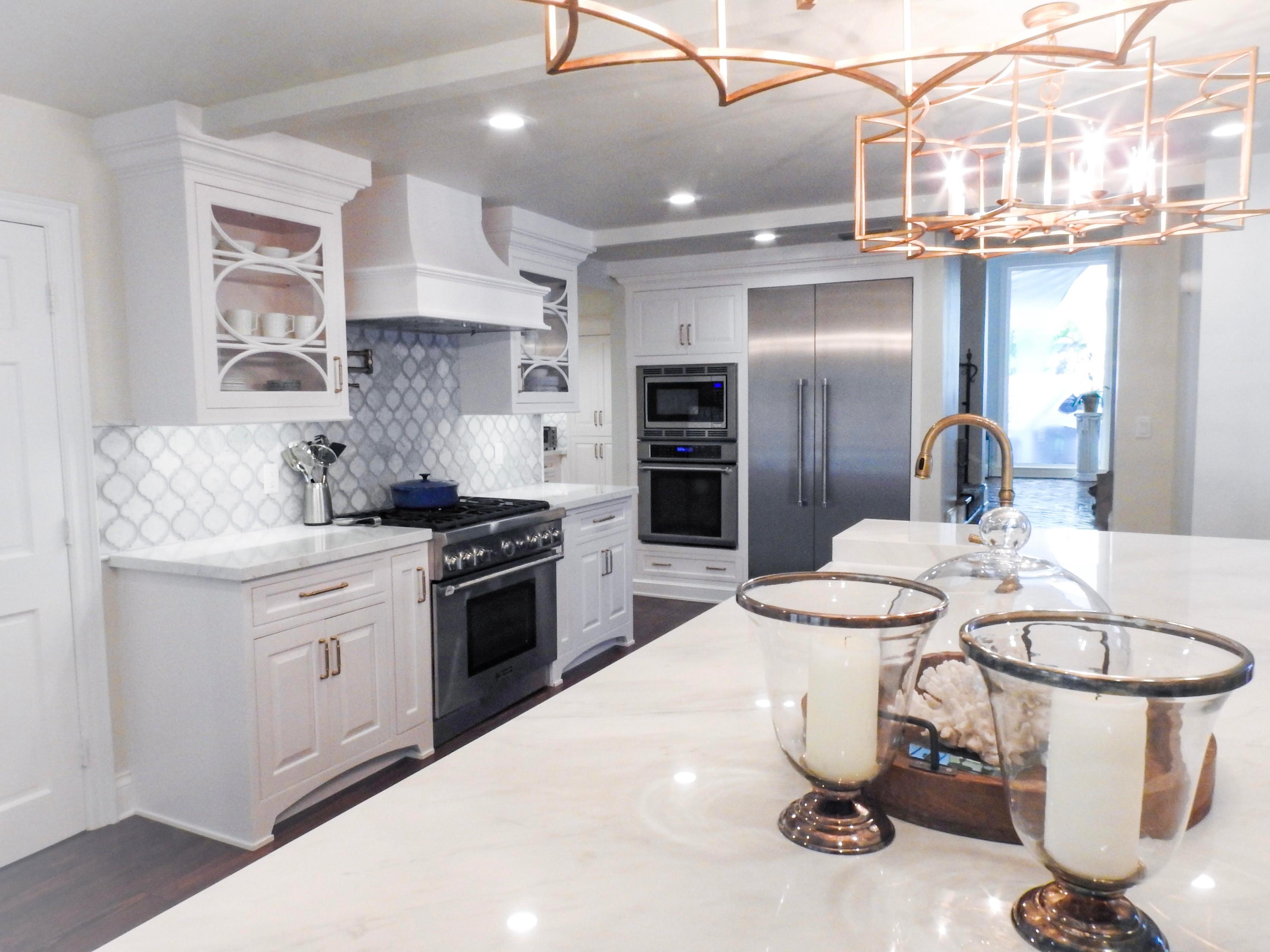Elegant kitchen, white cabinets by Amoroso Cabinets, center island