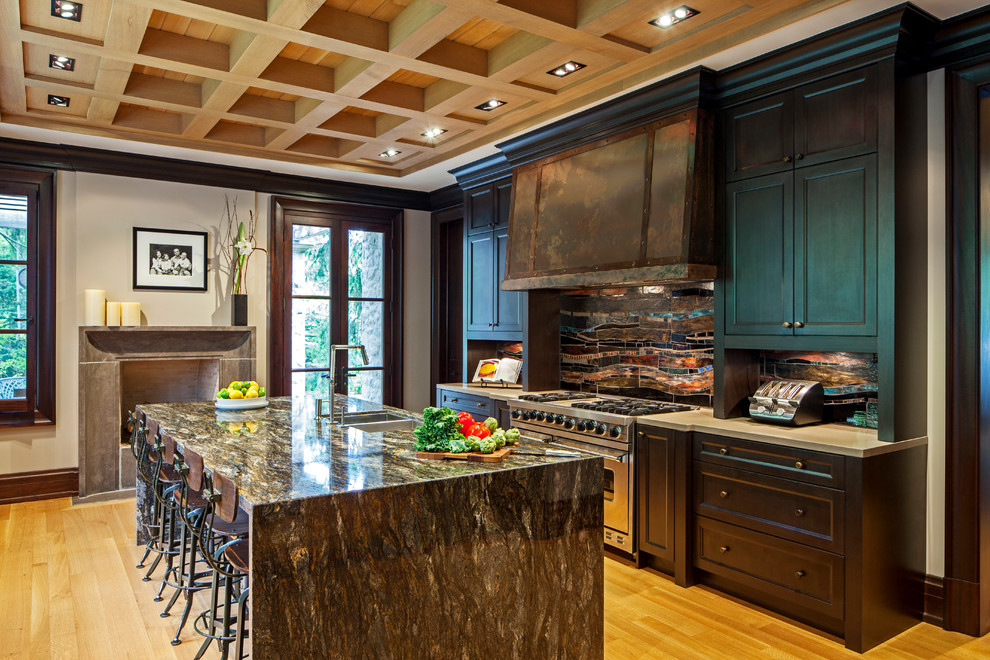 Eat-in kitchen - mid-sized eclectic galley light wood floor eat-in kitchen idea in Toronto with recessed-panel cabinets, dark wood cabinets, stainless steel appliances, a double-bowl sink, granite countertops, multicolored backsplash, mosaic tile backsplash and an island