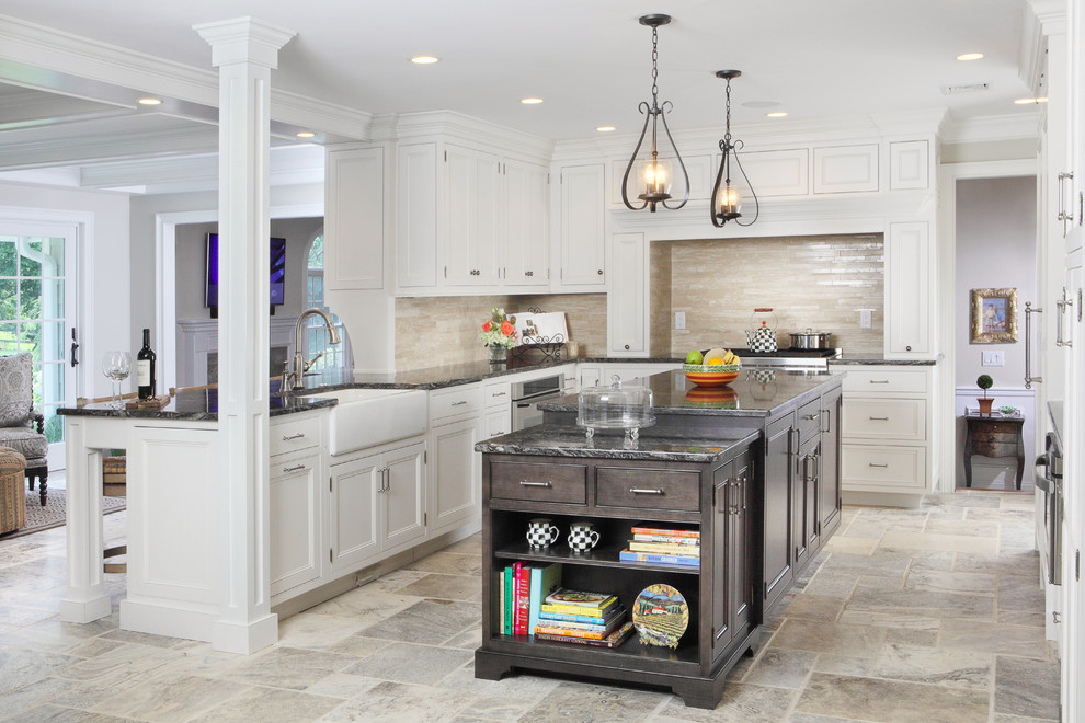 Eat-in kitchen - large transitional l-shaped travertine floor eat-in kitchen idea in New York with beaded inset cabinets, a farmhouse sink, granite countertops, white cabinets, beige backsplash, an island, stainless steel appliances and travertine backsplash