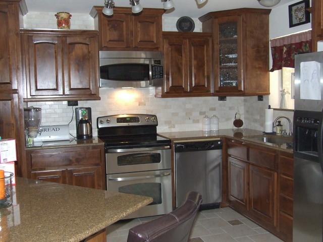 travertine backsplash traditional kitchen