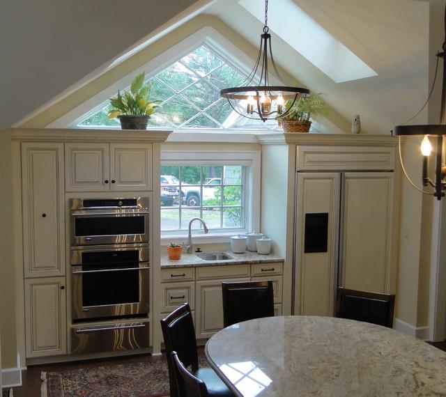 Triangle Kitchen Design: Triangle Window Above Custom Cabinets