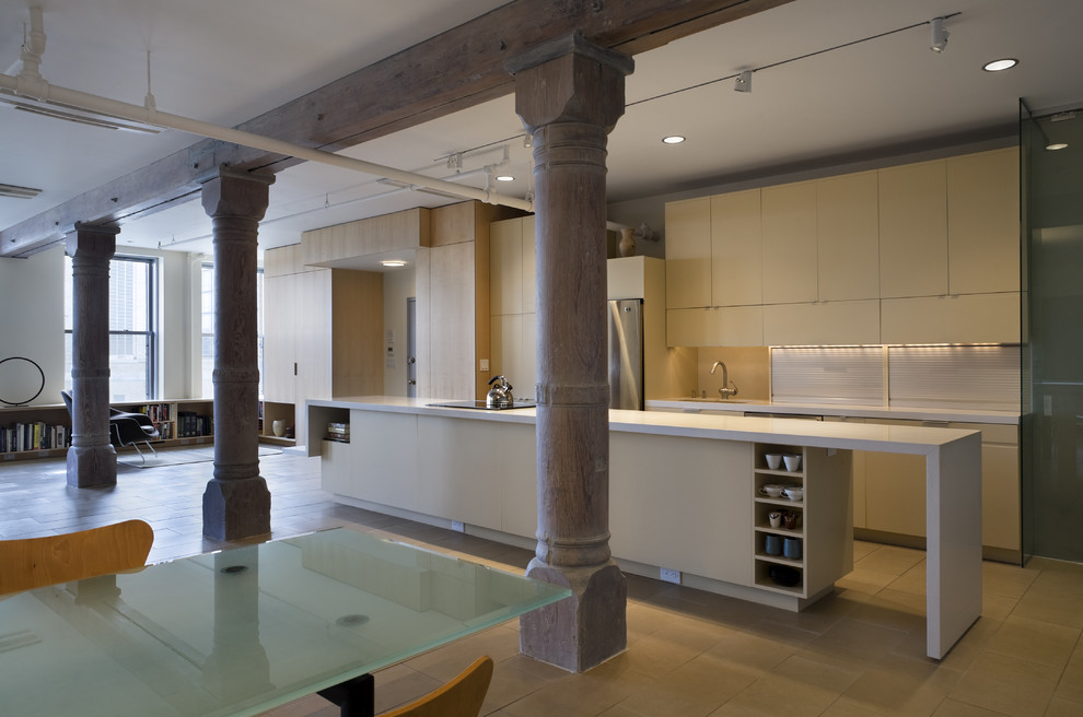 Inspiration for an industrial kitchen remodel in New York with stainless steel appliances