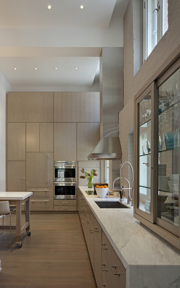 Example of a minimalist kitchen design in New York with stainless steel appliances