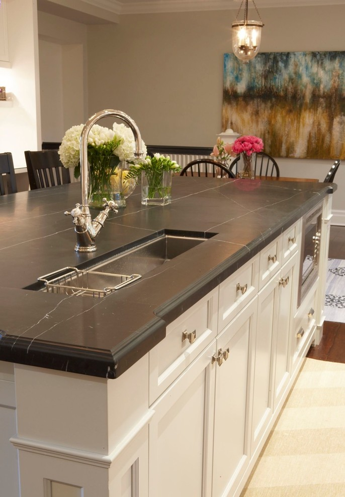 Elegant eat-in kitchen photo in Toronto with an undermount sink, recessed-panel cabinets and white cabinets