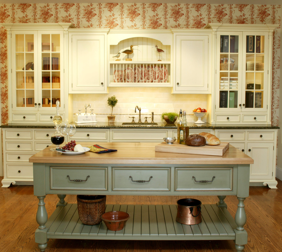 Inspiration for a farmhouse kitchen remodel in New York with recessed-panel cabinets, white cabinets, wood countertops, white backsplash and subway tile backsplash