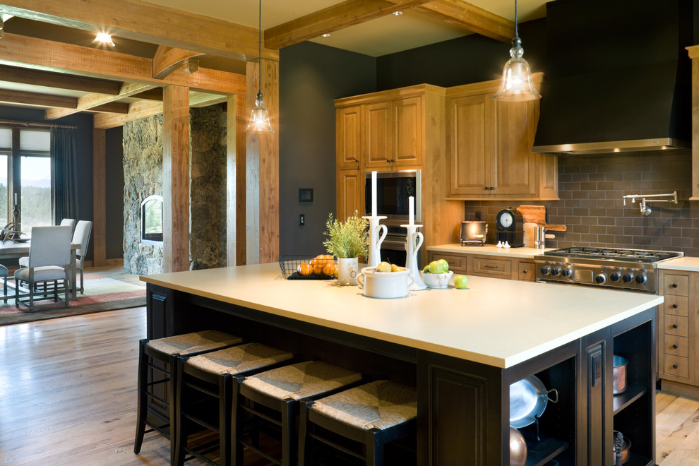 Example of a mountain style kitchen design in Portland with subway tile backsplash