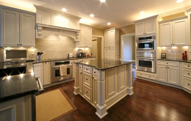 Tudor house traditional kitchen kansas city by for Tudor style home interior design