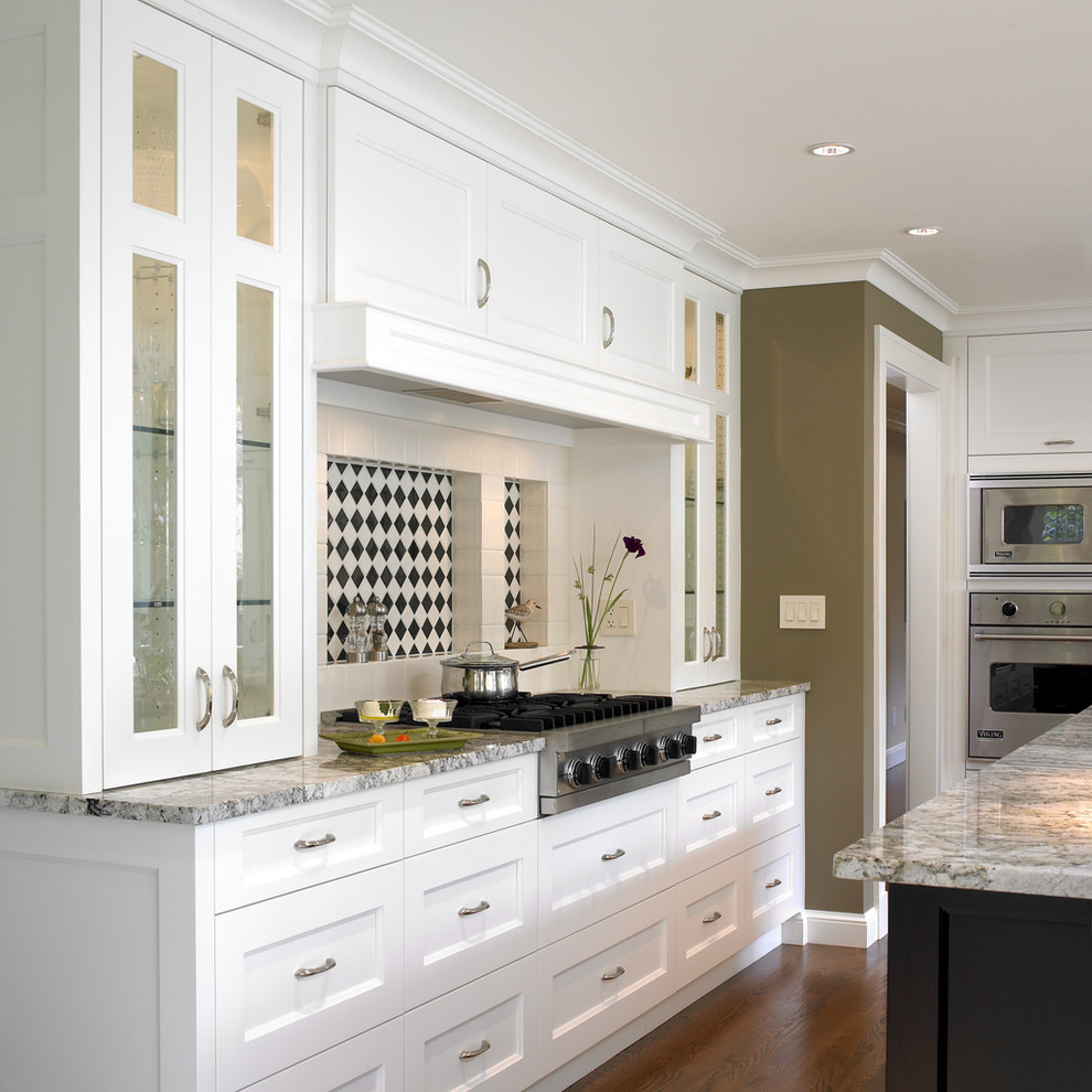 Transitional kitchen photo in Vancouver with glass-front cabinets and stainless steel appliances