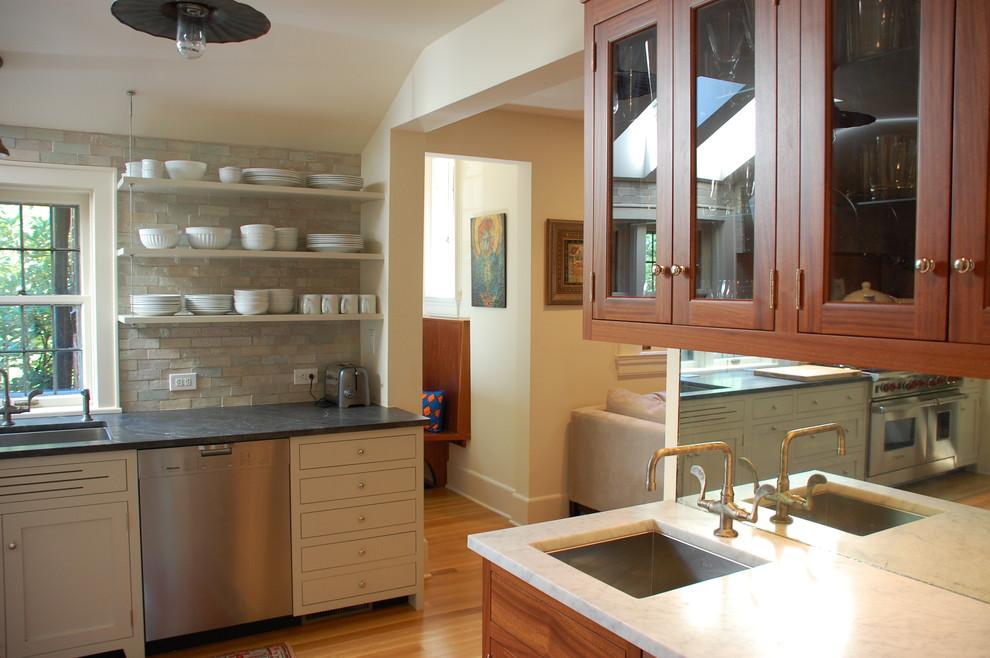 Inspiration for a timeless kitchen remodel in Newark with an undermount sink, granite countertops, beige backsplash and stone tile backsplash