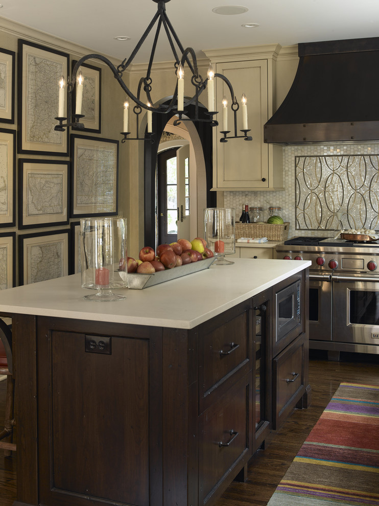 Example of a transitional kitchen design in Minneapolis with mosaic tile backsplash, stainless steel appliances, multicolored backsplash and dark wood cabinets