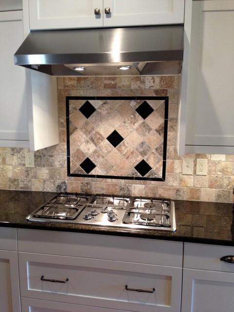 tumbled onyx backsplash with black pearl inserts craftsman kitchen