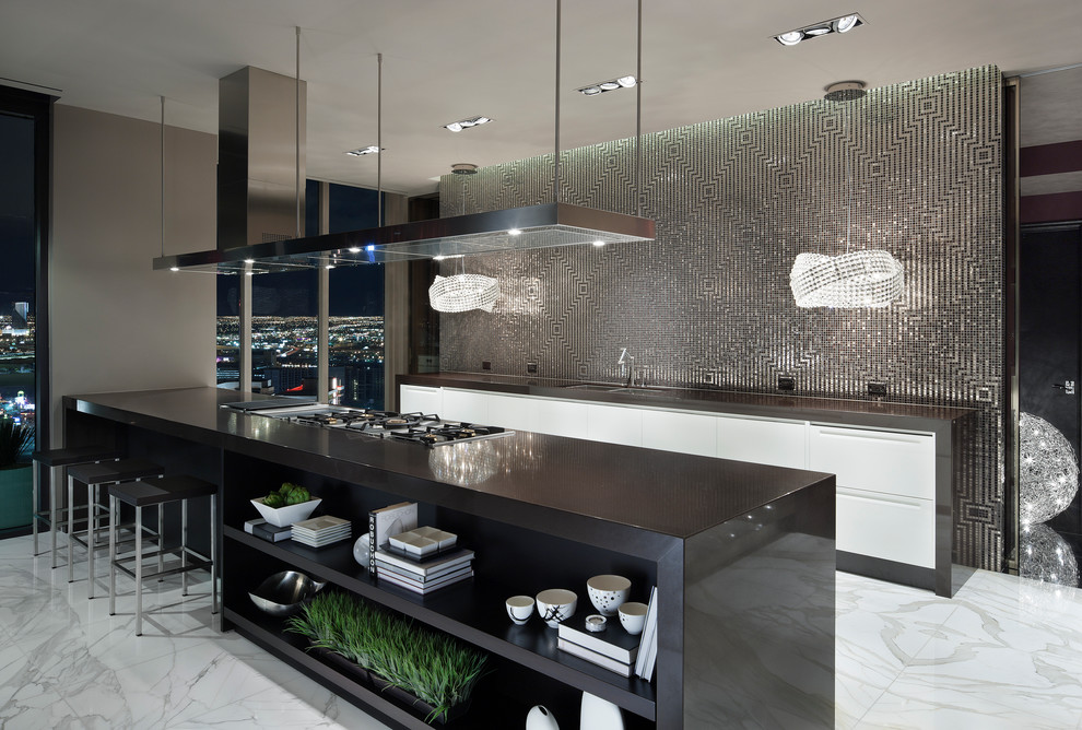Large trendy galley marble floor open concept kitchen photo in Las Vegas with a double-bowl sink, flat-panel cabinets, white cabinets, metallic backsplash, mosaic tile backsplash, laminate countertops, stainless steel appliances and a peninsula