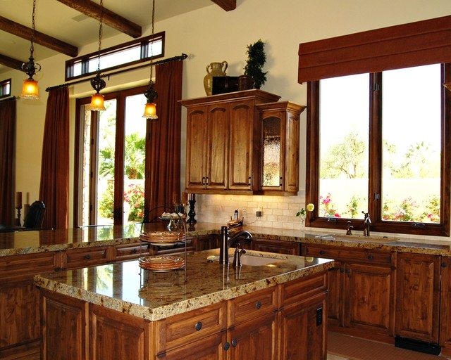 Tuscan Kitchen With Island And Antique Glass In Cabinet