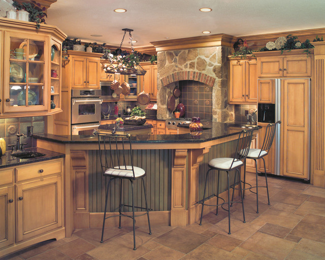 kitchen traditional u shaped kitchen idea in cleveland with recessed panel cabinets - Tuscan Style Kitchen