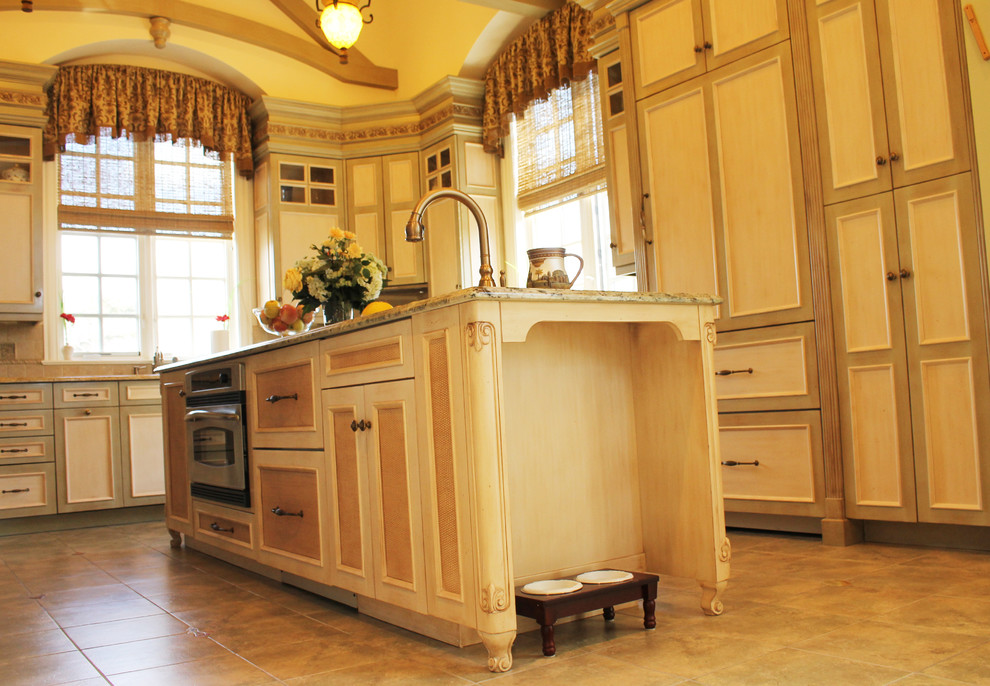 Eat-in kitchen - large mediterranean u-shaped ceramic tile eat-in kitchen idea in New York with raised-panel cabinets, light wood cabinets, marble countertops, multicolored backsplash, mosaic tile backsplash, colored appliances, an island and a single-bowl sink