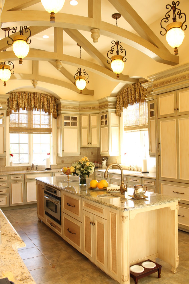 Inspiration for a large mediterranean u-shaped porcelain tile eat-in kitchen remodel in New York with raised-panel cabinets, light wood cabinets, marble countertops, multicolored backsplash, mosaic tile backsplash, colored appliances, an island and a single-bowl sink