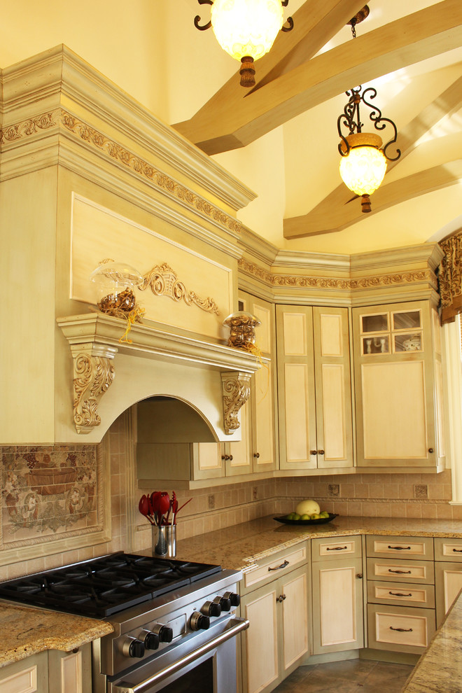 Inspiration for a large mediterranean u-shaped ceramic tile eat-in kitchen remodel in New York with raised-panel cabinets, light wood cabinets, marble countertops, multicolored backsplash, mosaic tile backsplash, colored appliances, an island and a single-bowl sink