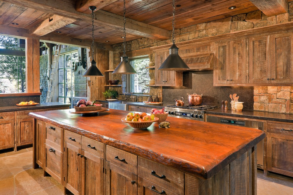 Mountain style kitchen photo in Other with recessed-panel cabinets, medium tone wood cabinets, wood countertops, gray backsplash, stone slab backsplash and stainless steel appliances