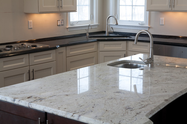 two tone kitchen: antique brown granite & millennium cream granite