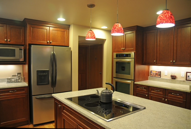 Kitchen with Red Pendant Lighting Over Island transitional kitchen