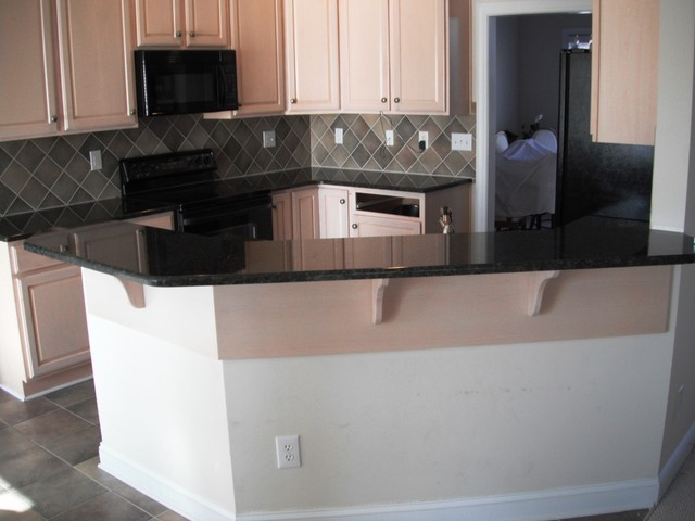 Uba Tuba Granite goes great with White Cabinets traditional-kitchen