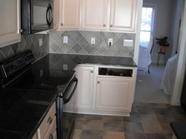 Uba Tuba Granite goes great with White Cabinets ...
