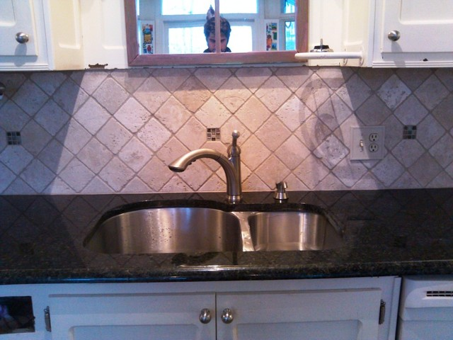 Uba Tuba Granite goes great with White Cabinets traditional kitchen