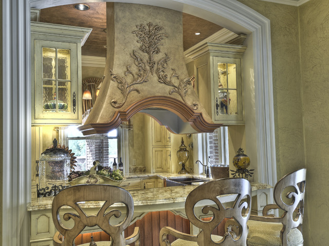 Unique twist on french country kitchen mediterranean for French colonial kitchen designs