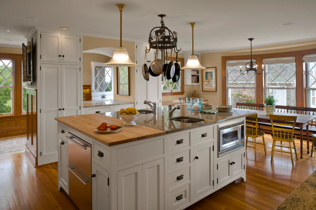 example of a classic kitchen design in providence with beaded inset cabinets granite countertops and