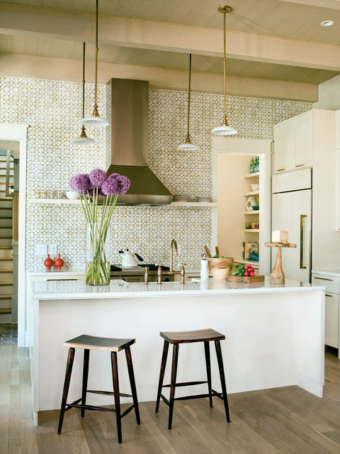 Inspiration for a transitional galley open concept kitchen remodel in Charleston with ceramic backsplash, paneled appliances and white cabinets