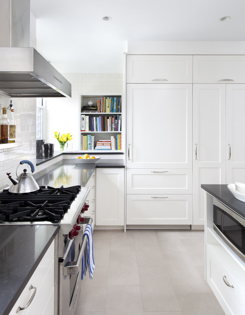 Example of a trendy kitchen design in New York with paneled appliances, subway tile backsplash and quartz countertops