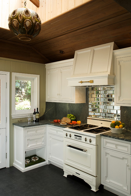 Mountain style kitchen photo in Los Angeles with recessed-panel cabinets, mirror backsplash, white appliances and white cabinets