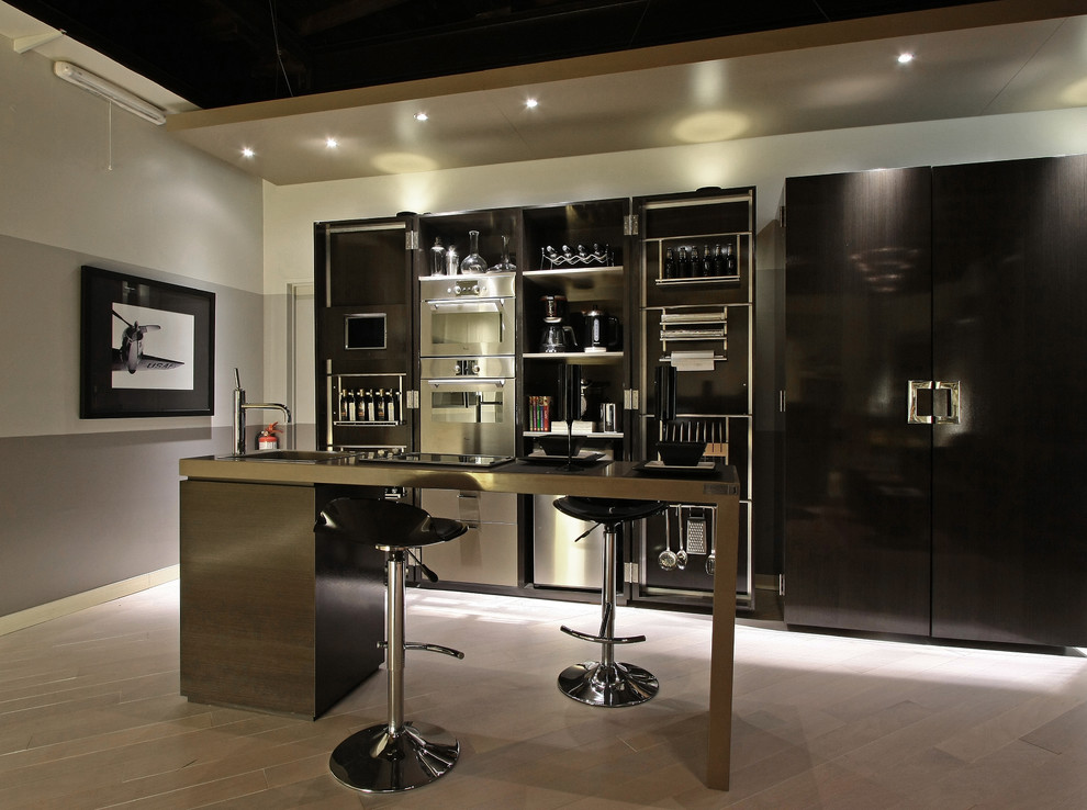 Inspiration for a contemporary galley kitchen remodel in Other with stainless steel appliances, flat-panel cabinets and black cabinets