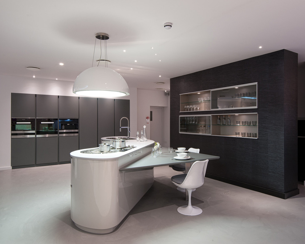 Inspiration for a large contemporary concrete floor kitchen remodel in London with an island, an undermount sink, flat-panel cabinets and gray cabinets