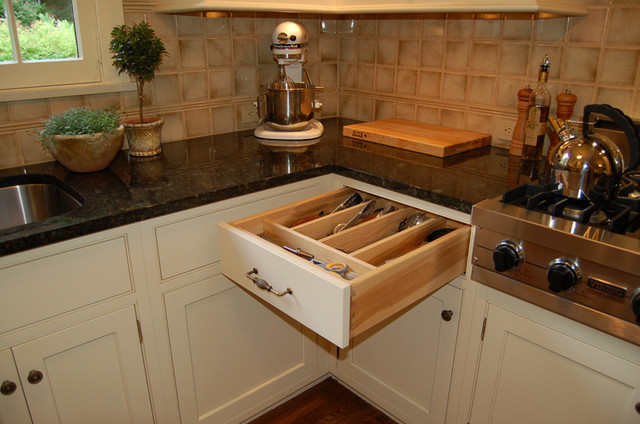 Utensil storage...Couldn't be more convenient! traditional-kitchen