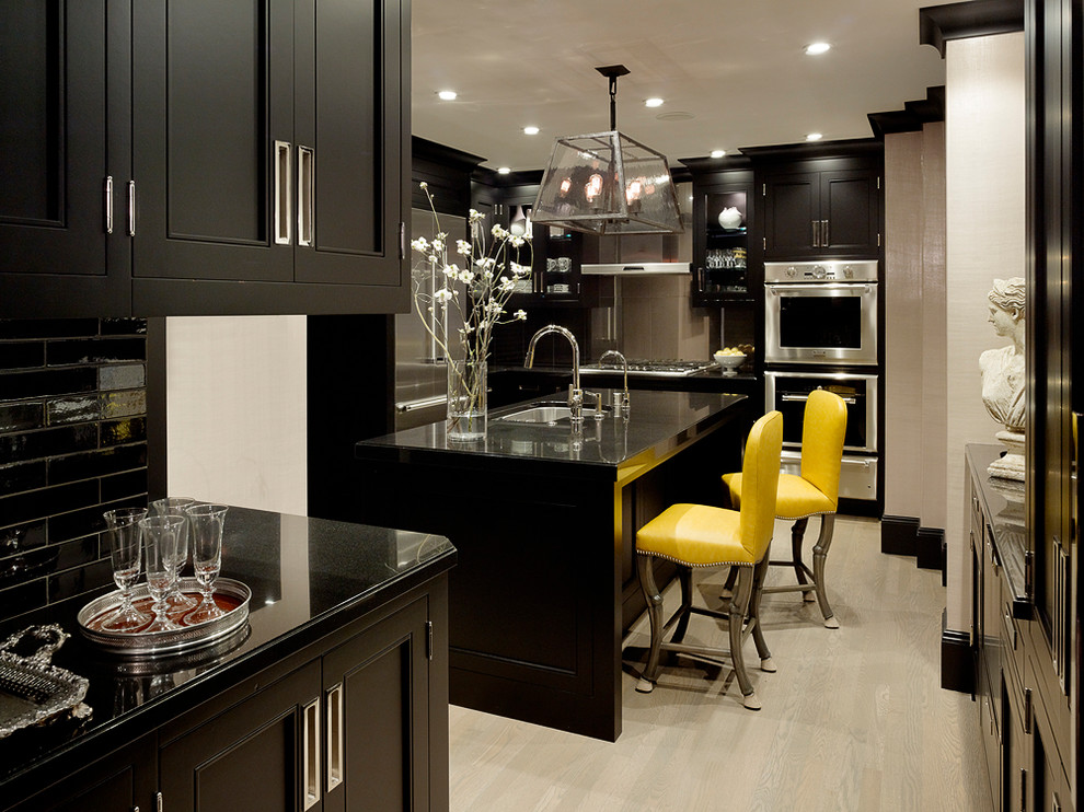 Enclosed kitchen - transitional enclosed kitchen idea in San Francisco with an undermount sink, recessed-panel cabinets, black cabinets, black backsplash, subway tile backsplash and stainless steel appliances