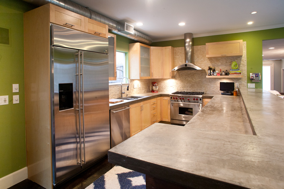 Inspiration for a modern kitchen remodel in Dallas with concrete countertops