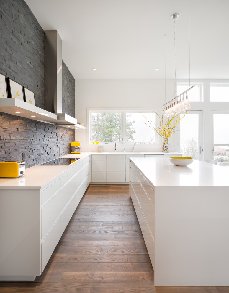 Inspiration for a modern kitchen remodel in Portland with flat-panel cabinets, white cabinets, gray backsplash, slate backsplash and white countertops