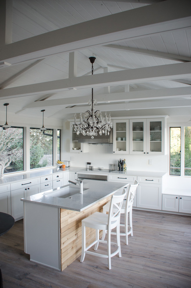 Example of a transitional l-shaped kitchen design in Seattle with an undermount sink, recessed-panel cabinets and white cabinets