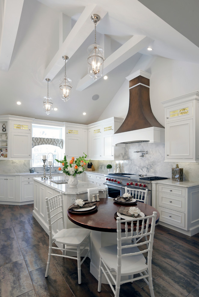 Example of a large cottage l-shaped porcelain tile eat-in kitchen design in New York with recessed-panel cabinets, white cabinets, white backsplash, stainless steel appliances, an island and an undermount sink
