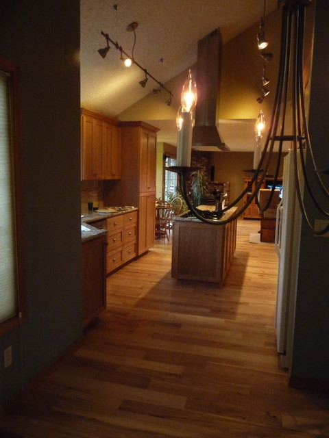 Vaulted Kitchen with hickory floors, cherry cabinets, steel and black appliances traditional-kitchen