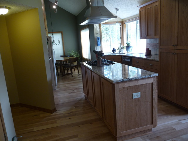 Vaulted kitchen with hickory floors cherry cabinets for Traditional kitchen appliances