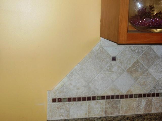 Venetian Ice Granite On Medium Colored wood traditional-kitchen