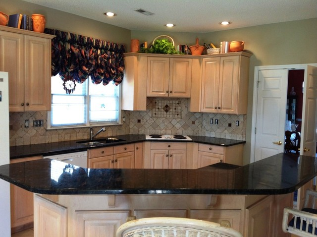 Captivating Verde Peacock Granite On Light Wood Kitchen Cabinets Traditional Kitchen