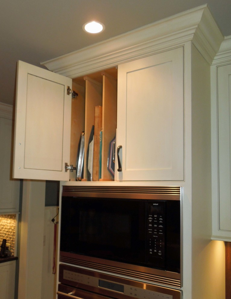 Inspiration for a mid-sized timeless l-shaped medium tone wood floor open concept kitchen remodel in Charleston with an undermount sink, beaded inset cabinets, white cabinets, granite countertops, brown backsplash, stainless steel appliances and an island