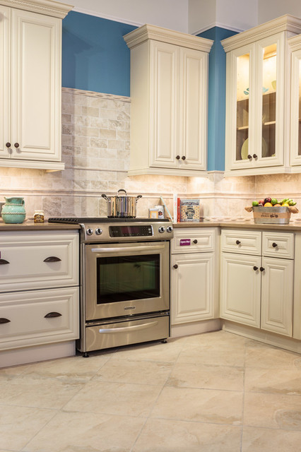 victoria ivory kitchen cabinets traditional kitchen