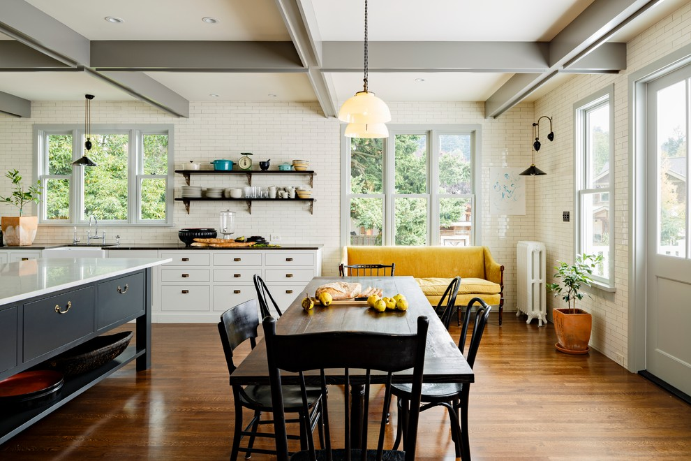Inspiration for a victorian eat-in kitchen remodel in Portland with a farmhouse sink, shaker cabinets, gray cabinets, marble countertops, white backsplash and subway tile backsplash