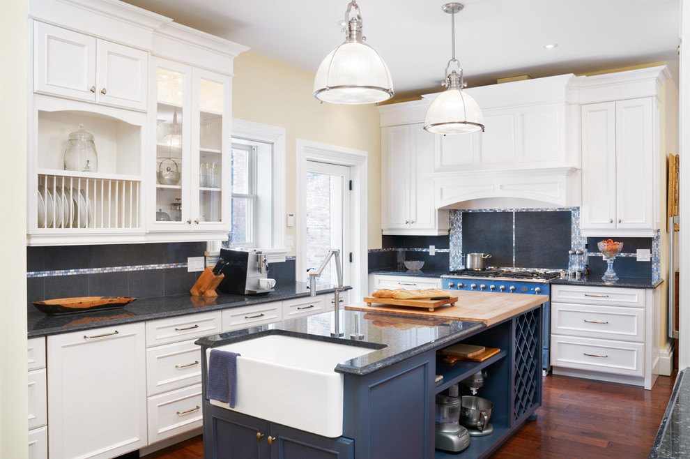 Example of an ornate kitchen design in Toronto with a farmhouse sink and colored appliances