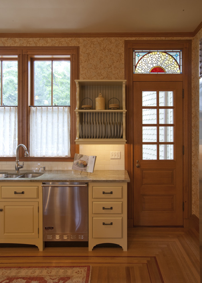 Inspiration for a victorian kitchen remodel in Boston with stainless steel appliances