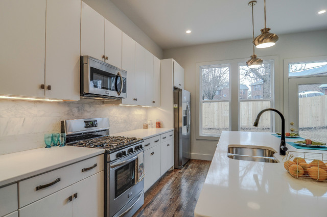 View of Kitchen with Mirada Antique Brushed Satin Brass Hardware eclectic-kitchen